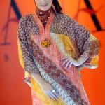Tunik draperi dan cheongsam, pilihan trendi untuk Lebaran