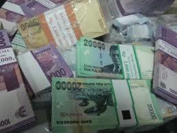 Ilustrasi uang tunai rupiah. (JIBI/Solopos/Dok.)