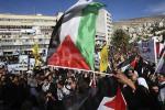 para warga Tepi Barat berpesta dan mengibarkan bendera Palestina, Jumat (20/11/2012). (Dok/JIBI/Solopos/Reuters)