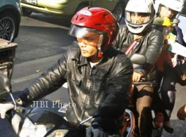 Pemudik bersepeda motor melintasi jalan Kota Solo pada musim mudik Lebaran 2012 lalu. (Dok Solopos)