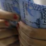 JIBI/Harian Jogja/Reuters Ilustrasi uang