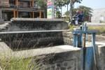 Salah satu pintu air irigasi pertanian di Desa Klodran, Kecamatan Colomadu, Karanganyar. Air dari saluran irigasi digunakan untuk mengairi sejumlah sawah di wilayah setempat. Foto diambil Rabu (28/8/2013). (Iskandar/JIBI/Solopos)