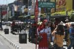 Sejumlah wisatawan berfoto dibawah papan nama Jalan Malioboro. (JIBI/Harian Jogja/Desi Suryanto)