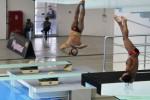 Dua peloncat indah Indonesia Akhmad Sukran Jamjami (kiri) dan Adityo Restu Putra (kanan) bertanding di babak final Loncat Indah nomor 3 Meter Springboard Synchronized Putra SEA Games Ke-27 di Wunna Theikdi Aquatic Center, Naypyitaw, Myanmar, Jumat (20/12/2013). Untuk nomor lomba itu, Indonesia meraih medali perunggu dengan total nilai 334,62 pada nomor tersebut. (JIBI/Solopos/Antara/Widodo S. Jusuf)
