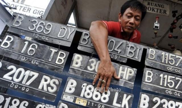 Ilustrasi pelat nomor kendaraan bermotor (JIBI/Solopos/Antara/Andika Wahyu)