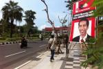 Baliho Jokowi terpasang di Jl. Yos Sudarso atau jalan menuju arah Balai Kota Surabaya. Foto diambil Kamis (6/3/2014). (Peni Widarti/JIBI/Bisnis)