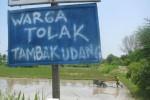 Papan penolakan pembangunan tambak udang (Bhekti Suryani/JIBI/Harian Jogja)