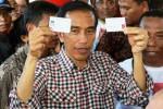 Ilustrasi capres Jokowi dan Kartu Indonesia Sehat (KIS) serta Kartu Indonesia Pintar (KIP) yang dijadikan andalan dalam setiap kampanye. (JIBI/Solopos/Antara/Widodo S. Jusuf)
