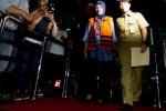 Masyito, istri Wali Kota Palembang Romi Herton mengenakan baju tahanan seusai diperiksa di Gedung Komisi Pemberantasan Korupsi (KPK), Jakarta, Kamis (10/7/2014). Ia diperiksa terkait kasus dugaan suap dalam penanganan sengketa Pilkada Kota Palembang di Mahkamah Konstitusi. (JIBI/Solopos/Antara/Wahyu Putro A.)