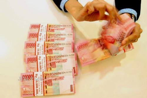 Ilustrasi uang tunai rupiah (JIBI/Bisnis)