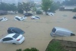 Cars are afloat in a flooded area in Geumjeong, Busan, Monday. Heavy rain hit the southern part of the country, causing flash floods, landslides, and suspension of subway service in some areas. (JIBI/Harian Jogja/The Korea Times/Yonhap)