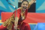 Atlet wushu putri Indonesia Juwita Niza Wasmi beraksi pada final kelas naquan/nandao Asian Games 2014 di Ganghwa Dolmens Gymnasium, Incheon, Korea Selatan, Sabtu (20/9/2014). Ia meraih medali perak dalam nomor tersebut dan menjadi penyumbang medali pertama bagi kontingen Indonesia dalam pesta olahraga Asia tersebut. (JIBI/Solopos/Antara/Saptono)