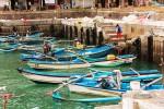Puluhan kapal Jukung milik nelayan tradisional bersandar di dermaga Pantai Sadeng. Akibat kalah bersaing dengan kapal besar, banyak yang berhenti melaut. Foto diambil Jumat (7/11/2014). (JIBI/Harian Jogja/David Kurniawan)