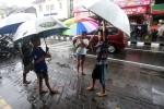 Jasa ojek payung (JIBI/Harian Jogja/Gigih M. Hanafi)