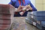 Ilustrasi menghitung uang (Nurul Hidayat/JIBI/Bisnis)