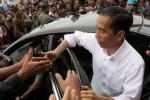 Presiden Jokowi di tengah pengungsi Gunung Sinabung (JIBI/Solopos/Antara/Irsan Mulyadi)