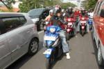 Sejumlah jurnalis melakukan test ride Suzuki Address menyusuri jalan di Kota Semarang, Sabtu (22/11/2014). (Insetyonoto/JIBI/Solopos)
