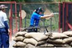 Frangky, atlet menembak asal Indonesia, beraksi di salah satu stage dalam Kejuaraan Tembak Reaksi dalam Kejuaraan Menembak Internasional Marines Anniversary Cup 2014 di Lapangan Tembak Internasional F.X Soepramono, Bhumi Marinir, Karangpilang, Surabaya, Jawa Timur, Sabtu (13/12/2014). Kejuaraan Menembak Reaksi Level II/IPSC itu diikuti tujuh negara yang terdiri atas 480 peserta, TNI dan Polri, anggota klub menembak (sipil) nasional maupun luar negeri. Kejuaraan menembak tersebut bertujuan untuk menjaga hubungan harmonis antara masyarakat dan Korps Marinir. (JIBI/Solopos/Antara/M Risyal Hidayat)