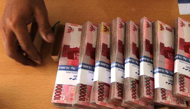 Ilustrasi uang tunai rupiah. (Rahmatullah/JIBI/Bisnis)