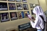 Pengunjung Masjid Agung Demak catat informasi, Rabu (21/1/2015). (JIBI/Solopos/Antara/Aditya Pradana Putra)