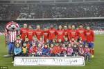 Tim Atletico Madrid dengan para fans kecil mereka berfoto dalam sebuah pertandingan. Ist/dailymail.co.uk/ilustrasi