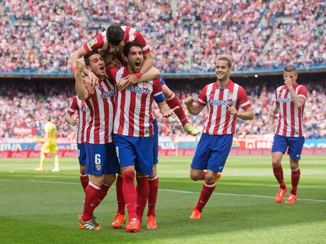 Para pemain Atletico Madrid melakukan selebrasi. (Ist/sportmole.co.uk)