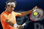 Roger Federer mengembalikan bola ke arah Verdasco di laga ATP Championships Dubai. JIBI/Rtr/Ahmed Ja