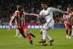 Real Madrid saat bertemu Atletico Madrid beberapa waktu lalu. Derby Madrid nanti malam akan kembali tersaji. Ist/freesportsbetsips.com