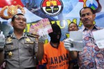 Polisi Jatim mengaku menangkap perekrut TKI ilegal, Jumat (27/3/2015). (JIBI/Solopos/Antara/Herman Dewantoro)