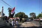 Pasukan pengibar bendera mengibarkan bendera Merah Putih pada upacara Hari Kebangkitan Nasional di Tugu Lilin, Penumping, Solo, Rabu (20/5/2015). (Reza Fitriyanto/JIBI/Solopos)