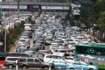 Adu Wacana Sandiaga vs Ahok Soal Solusi Kemacetan Jakarta