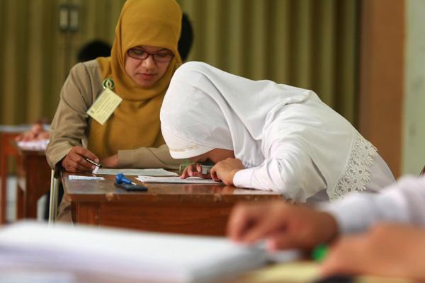 Ujian Nasional SMP (JIBI/Harian Jogja/Desi Suryanto)