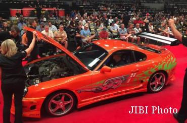 Suasana lelang Toyota Supra Paul Walker di Mecum Auction. (Autoevolution.com)