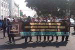 Aksi diam Forum Umat Islam menuntut pembunuh Eka Mayasari dihukum berat di Titik Nol Kilometer, Jogja, Jumat (22/5/2015). (JIBI/Harian Jogja/Ujang Hasanudin)