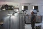 Humas Koperasi Jasa Usaha Bersama (KJUB) Puspeta Sari, Sulistyo Sudibyo, mengamati tabung penyimpan susu di pabrik pengolahan susu di Karangnongko, Klaten, Sabtu (23/5/2015). Gara-gara pabrik susunya digeledah aparat Satreskrim Polres Klaten, Jumat (22/5/2015) pagi, manajemen pabrik pengolahan susu mengalami kerugian material dan moril. (JIBI/Solopos/Ponco Suseno)