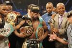 Floyd Mayweather, Jr. pose dengan sabuk juaranya seusai kalahkan Manny Pacquiaol. JIBI/Rtr/Steve Mar