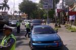 Sejumlah kendaraan dirazia polisi di Jalan Jenderal Sudirman (Simpang McDonald's) Jogja dalam Operasi Patuh Progo, Jumat (29/5/2015)/ Foto Istimewa