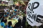 Siswa SDN Nayu Barat 2 Solo kirim doa untuk Angeline, Jumat (12/6/2015). (Reza Fitriyanto/JIBI/Solopos)