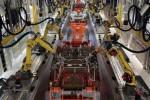 Ilustrasi robot lengan di pabrik VW. (Huffingtonpost.com)