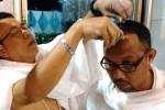 Ilustrasi mencukur rambut setelah haji (Kemenag.go.id)