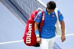 Petenis Jepang Kei Nishikori keluar dari lapangan tenis seusai dikalahkan petenis Prancis Benoit Paire di babak pertama US Open 2015.  JIBI/Reuters/Geoff Burke-USA TODAY Sports