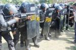 Ilustrasi persiapan Brimob mengendalikan keamanan Madiun. (Tribratanews.my.id)