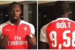 ULAH SUPORTER : Kalah Taruhan,Usain  Bolt Terpaksa Pakai Jersey Arsenal
