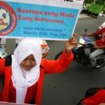 Sejumlah pelajar mengampanyekan pencegahan nikah dini di Kota Kediri, Minggu (6/12/2015). (JIBI/Solopos/Antara/Prasetia Fauzani)
