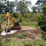 Ekskavator BBWSBS di Sungai Dengkeng digunakan untuk mengeruk sedimen Sungai Dengkeng. (Taufiq Sidik Prakoso/JIBI/Solopos)