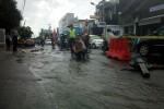 CUACA EKSTREM : Aspal Jalan AM Sangaji Jogja Pecah Usai Hujan Deras