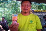 Sudiyono saat menunjukan salah satu makanan berbahan baku kakau yang ada di Desa Nglanggeran, Patuk. Minggu (24/4/2016). (David Kurniawan/JIBI/Harian Jogja)