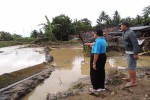 Tanggul di Sungai Seling ambrol sehingga luapan air meratakan sebuah tanah. (Sekar Langit Nariswari/JIBI/Harian Jogja)