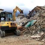Petugas penyelamat bekerja di bangunan yang roboh akibat gempa di Italia, Rabu (24/8/2016). (JIBI/Reuters/Emiliano Grillotti)