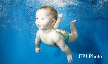 Ilustrasi seorang bayi (merries.co.id)